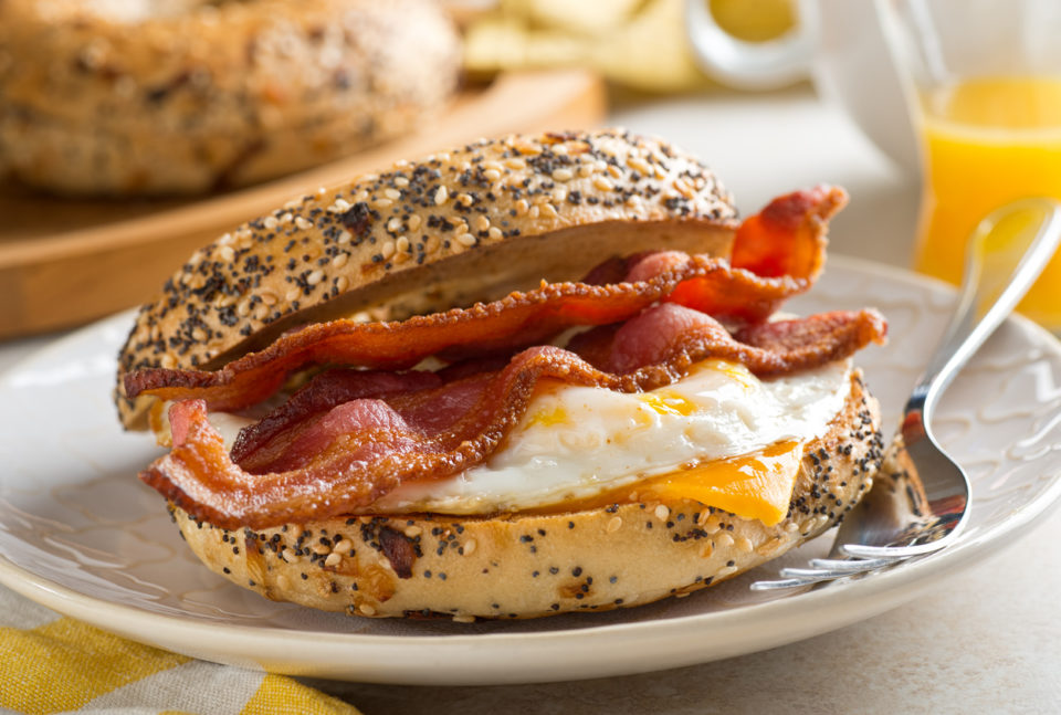 A breakfast bagel with bacon, egg and cheese.